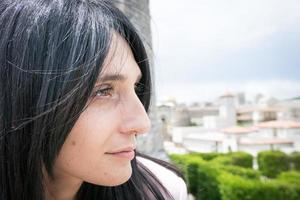 Close-up of a woman looking at a city photo