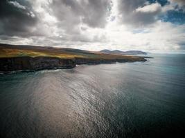 Dramatic aerial view of the cliffs off the Irish coast photo