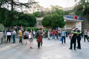 Tbilisi, Georgia, Apr 06. 2020 - Peaceful protestors standing in front of Rustaveli metro station photo