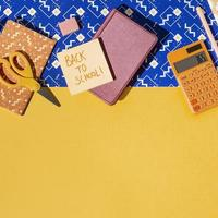 Top view school supplies on the table composition photo