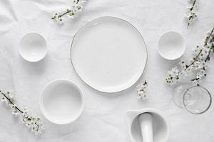 White tableware with white flowers photo