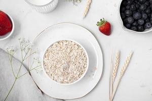 Oats with blueberries and strawberries photo
