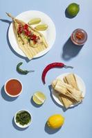 Flat lay arrangement of tamales ingredients photo