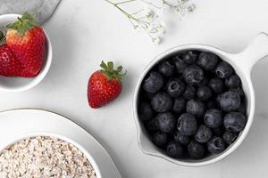 Blueberries and strawberries with oats photo