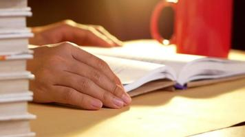 Close up of a Hand of a Young Women Reading a Book Sits on Table at Home video