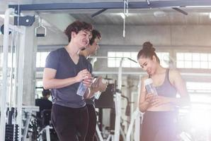 Young Asian couples are exercising in the gym. Concept of exercise for good health of the new generation. photo