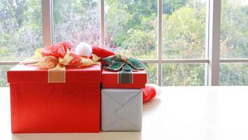 Red christmas gift box on the table photo