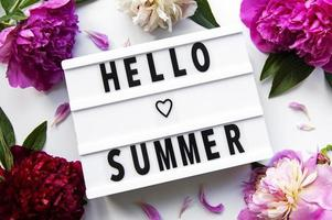 Lightbox with text HELLO SUMMER and peony flowers photo