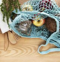 Mesh bag with fruits photo