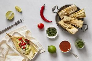 Arrangement of delicious tamales on plate photo