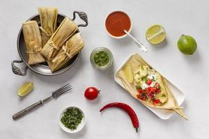 Composition of delicious tamales on plate photo