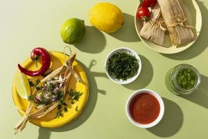 Assortment of tamales ingredients on a green table photo