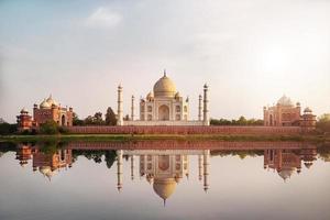 Sun set at Taj Mahal seen from Mehtab Bagh reflect on Yamuna river. photo