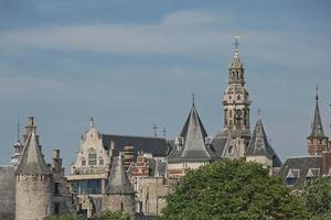Cityscape of a port of Antwerp in Belgium over the river. photo
