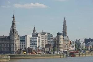 Cityscape of a port of Antwerp and cathedral of our lady in Belgium over the river photo