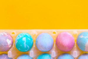 Easter eggs with space intergalactic pattern on yellow background photo