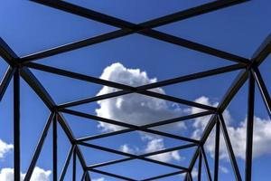 Silhouette of metal frame and blue sky background. photo