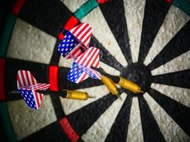American darts arrows in target photo