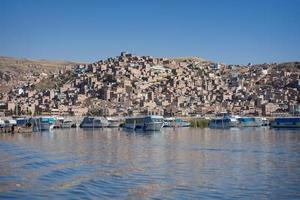 Puno, Peru. Cityscape on the Titicaca lake photo