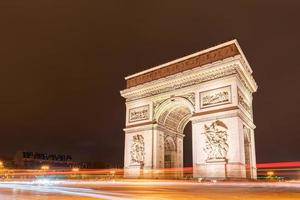 Light trail of the street in front of The Arc de Triomphe. photo