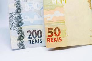 Banknotes of two hundred and fifty reais, totaling two hundred and fifty. Expected amount for emergency aid in Brazil in the year 2021. photo