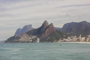 Two hill brothers, gavea stone and beautiful stone, views of arpoador beach in Rio de Janeiro. photo
