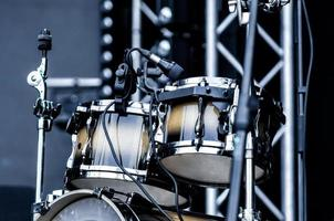 Drum with microphone on stage, close up photo