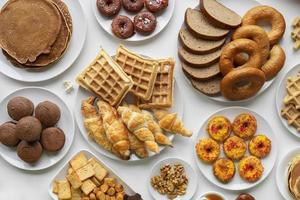 Breads, waffles, donuts, and croissants top view photo