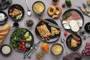 Vegetables, meats, and breads top view assortment photo