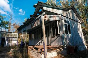 Old abandoned wooden village house in Ukraine photo