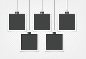 Retro photo frames hanging on a wall vector