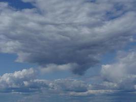 Rain clouds in blue sky photo