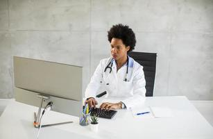 Doctor working in an office photo