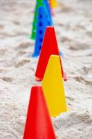 Colorful icons used to practice functional exercises on the beach photo