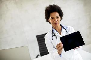 Doctor holding a blank tablet photo