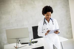 Doctor checking paperwork photo