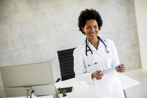 Doctor holding documents and smiling photo