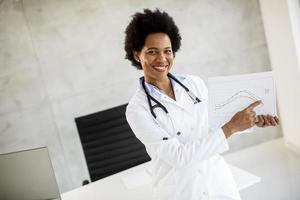 Doctor pointing to a chart photo