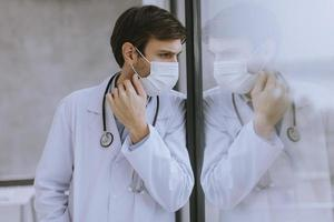 Doctor adjusting mask photo