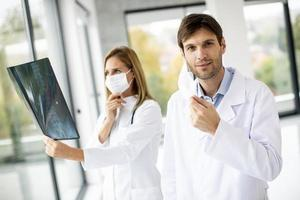 Doctor taking off his mask photo