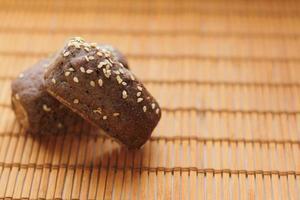 Mini bread on wooden background photo