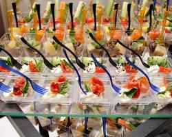 decorated catering banquet table with cheese tomato pate and cold snacks photo