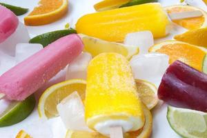 Ice creams with fruit and ice on white background photo
