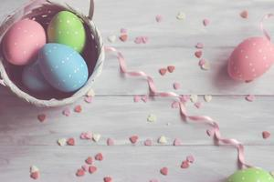 Decorative easter eggs on white wooden background photo