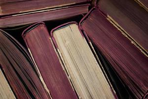 Top view of a stack of old hard back books photo