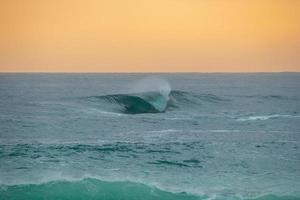 Secret wave on Ipanema beach breaking lonely photo