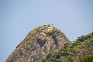 People gathered on the summit of Two Hill Brother in Rio de Janeiro photo