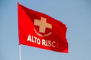 Red flag written in Portuguese, high risk on Copacabana beach in Rio de Janeiro photo