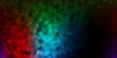 Dark multicolor vector background with hexagonal shapes.