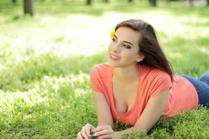 Woman laying in the grass photo